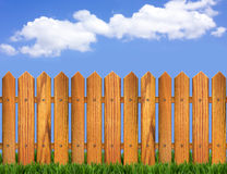 Wood fence and blue sky horizon. Background for design stock photography