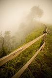 Wood fence on the cliff with fog Stock Photography