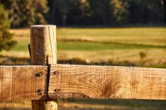 Wood fence on a countryside background royalty free stock photography