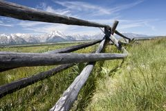 Wood fence frames Tetons. Stock Images
