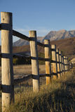 Wood fence line with autumn foliage on mountains Royalty Free Stock Image