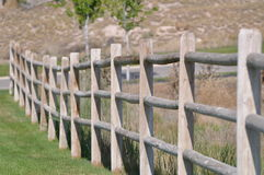 Wood Fence Line lining a park area Royalty Free Stock Photo