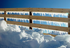 Wood fence in mountain border. Ice melting in wood fence mountain border (Metafhor to global warming Stock Photos