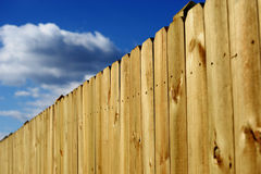 Wood fence perspective view. Against blue sky Royalty Free Stock Photography