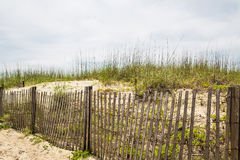 Wood Fence and Sand Dunes Stock Photo