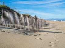 Wood fence at the sandy beach of Hatteras Island. NC Stock Images