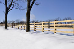 Wood fence by snow Royalty Free Stock Images
