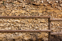 Wood Fence with Stone Background Royalty Free Stock Photography