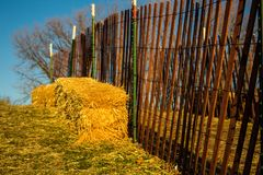 wood fence and straw bales royalty free stock images