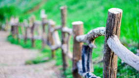 Wood fenced path on the slope of a grass hill Royalty Free Stock Photos