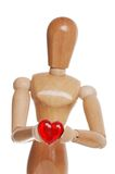 Wood Figure Holding Plastic Red Heart Royalty Free Stock Image