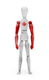 Wood figure mannequin with flag bodypaint - Canada. Wood figure mannequin with flag bodypaint on white background - Canada Stock Photography
