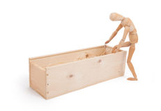 Wood figure mannequin stepping in a wooden box. Concept of death or retail royalty free stock photography