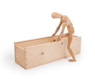 Wood figure mannequin stepping in a wooden box Royalty Free Stock Images