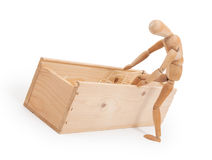 Wood figure mannequin stepping in a wooden box Stock Image