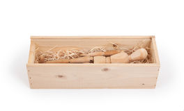 Wood figure mannequin in a wooden box. Concept of death or retail stock photos