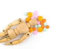 Wood figure with  medicine isolate Stock Image