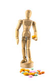 Wood figure with  medicine isolate Royalty Free Stock Image