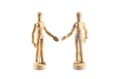 Wood figure shake hands Royalty Free Stock Images