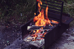 Wood Fire in Black Metal Fire Pit Royalty Free Stock Photo