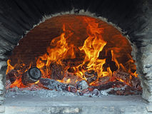 Wood fire in a bread oven Stock Photography