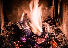 Wood in fire burning in old stove with ember Royalty Free Stock Photos