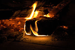 Wood in fire 3. Heat the fireplace on a cold winter evening Royalty Free Stock Photo