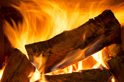 Wood Fire. Logs of wood burning bright in a wood fire Royalty Free Stock Photo