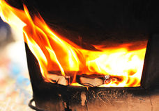 wood fire and old stove Royalty Free Stock Images