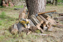 Wood for fire. Photography of cleaved wood and axe, prepard for fire Royalty Free Stock Photo