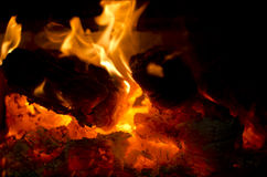 Wood fire red hot coal. Red hot burning wood with flames. Glowing, cracking wood fire has lot of red ember and some flames stock photos