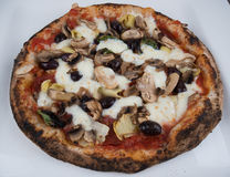 Wood Fired Artichokes Olives and Mushrooms Pizza Royalty Free Stock Image
