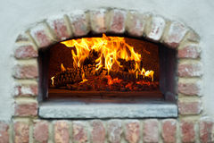 Wood fired oven. A beautiful wood fired oven with focus on fire Stock Photos