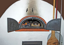 Wood fired oven with open door Royalty Free Stock Images
