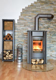Wood fired stove. With fire-wood, fire-irons, and briquettes from bark Stock Photos