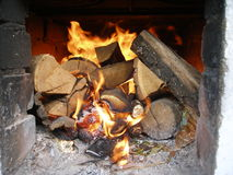 Wood in the fireplace Stock Images