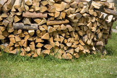Wood for fireplace. On a green grass Stock Images