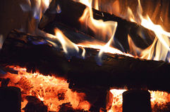 Wood in the fireplace. Is burning and it is warm Royalty Free Stock Images