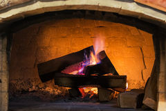 Wood fireplace system with purple flame Royalty Free Stock Photos