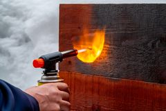 Wood firing using the old Japanese method royalty free stock photo