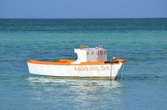 Wood Fisherman`s Boat Anchored in Aruba off Palm Beach Royalty Free Stock Image