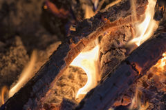 Wood flames on fire place and black background Royalty Free Stock Image