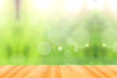 Wood floor and abstract green bokeh background Stock Image