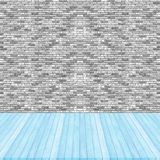 Wood floor blue pastel colour perspective on brick wall gray col Royalty Free Stock Photo
