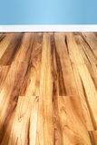 Wood floor and blue wall Stock Images