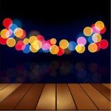 Wood floor and blurred night scene background Stock Image