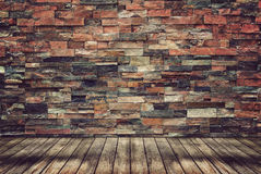Wood floor and brick wall for Vintage wallpaper royalty free stock image