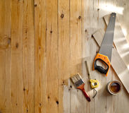 Wood floor with a brush, paint and tools. Wood floor texture with a brush, paint and tools royalty free stock image