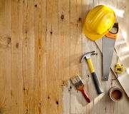 Wood floor with a brush, tools and helmet stock photos