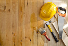 Wood floor with a brush, tools and helmet Royalty Free Stock Photography
